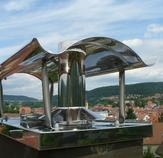 Bild nach der Montage einer neuen Edelstahlabdeckplatte mit einer Schwarzwaldhaube aus Edelstahl. Ort: Nagold